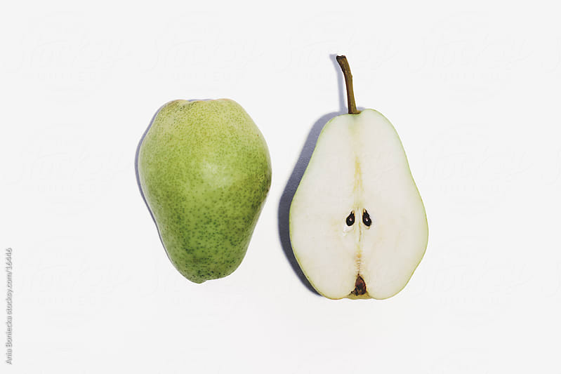 Two halves of a pear by Ania Boniecka for Stocksy United