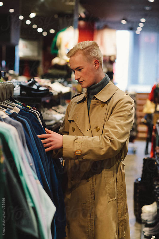 fashionable man shopping for vintage clothes. by kkgas for Stocksy United