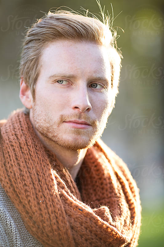 Man With an Orange Scarf by Lumina for Stocksy United