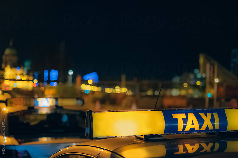 Taxi Light. City Night by HEX. for Stocksy United
