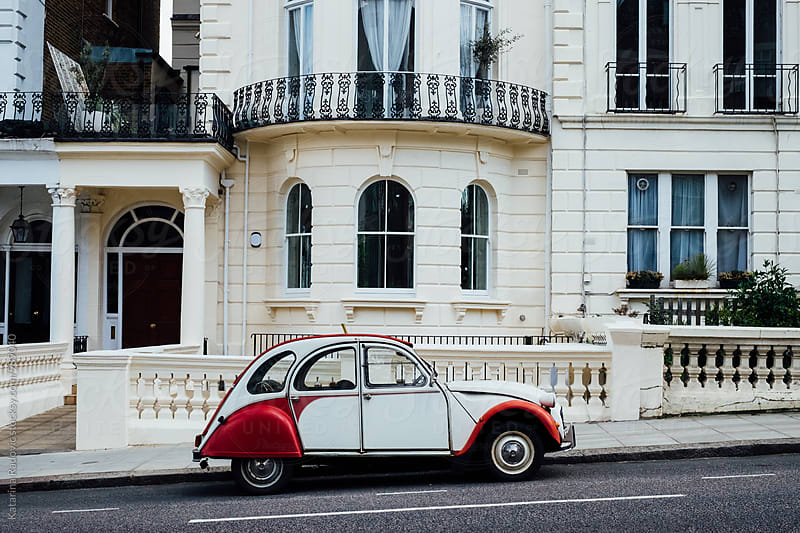 Old Retro Car in Front of the English House by Katarina Radovic for Stocksy United