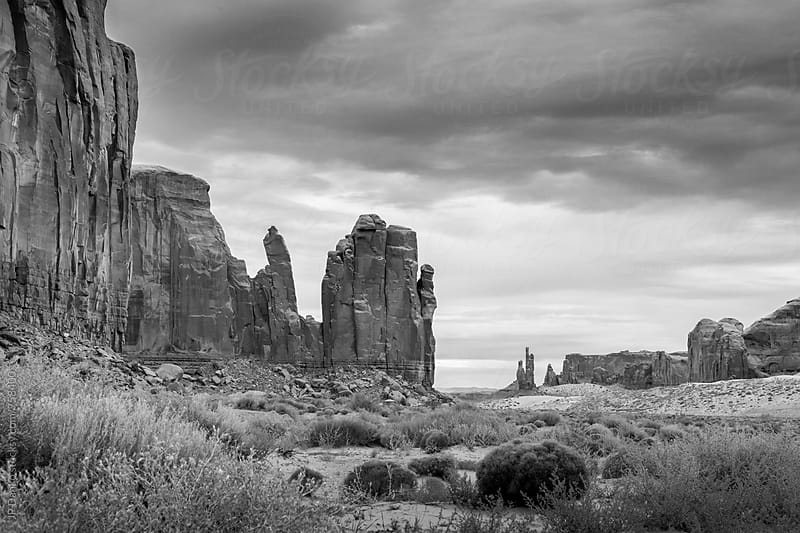 Monument Valley Utah USA Navajo Nation in Black and White Under Cloudy Dramatic Desert Sky by JP Danko for Stocksy United