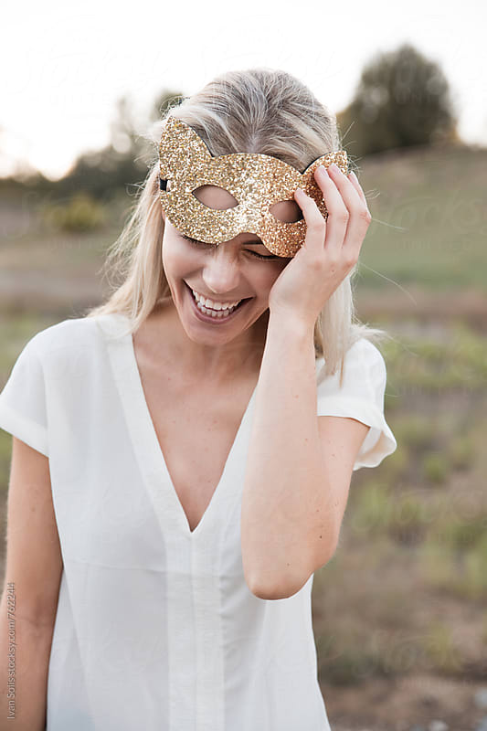 Woman with cat mask by Ivan Solis for Stocksy United