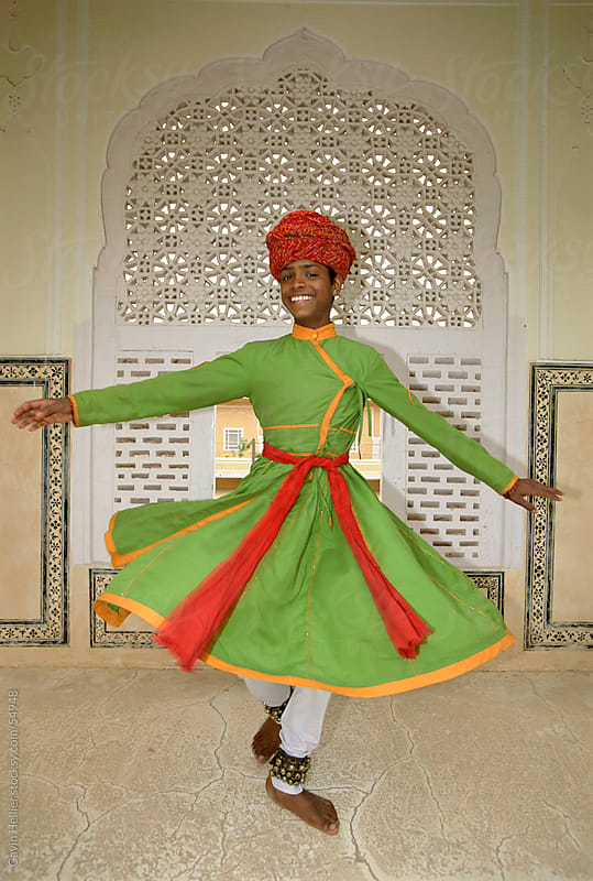 India, Rajasthan, Jaipur, boy dancing in Samode Palace by Gavin Hellier for Stocksy United