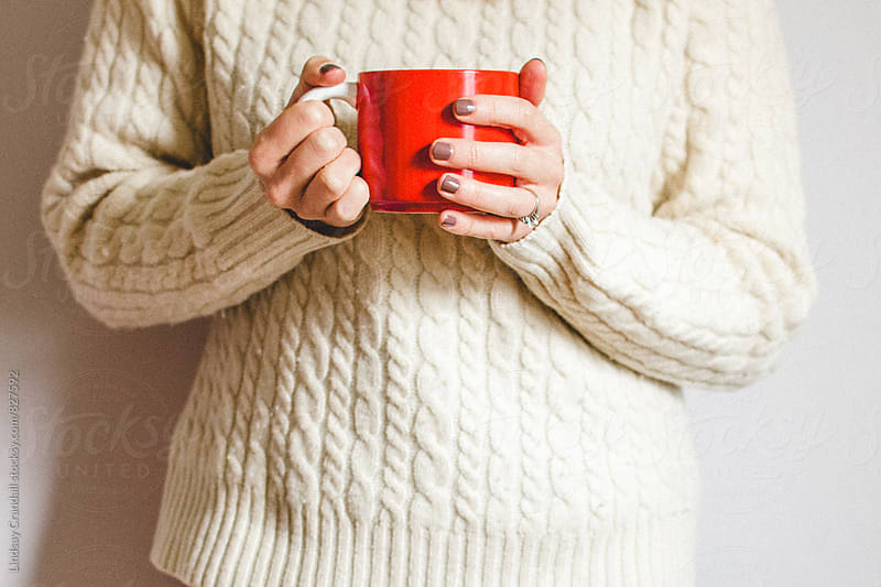 Women holding red coffee mug by Lindsay Crandall for Stocksy United