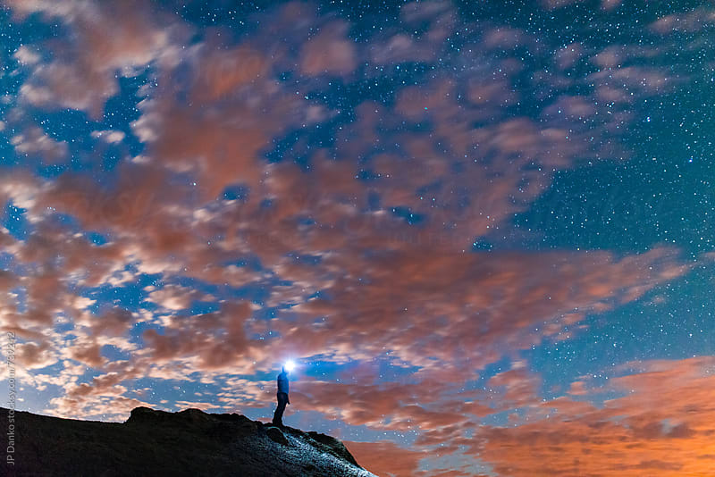 Man On Hoodoo at Night in Bisti Badlands Bisti/De-Na-Zin New Mexico and Night Sky by JP Danko for Stocksy United