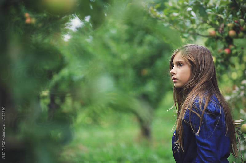 Girl In the Orchard by ALICIA BOCK for Stocksy United