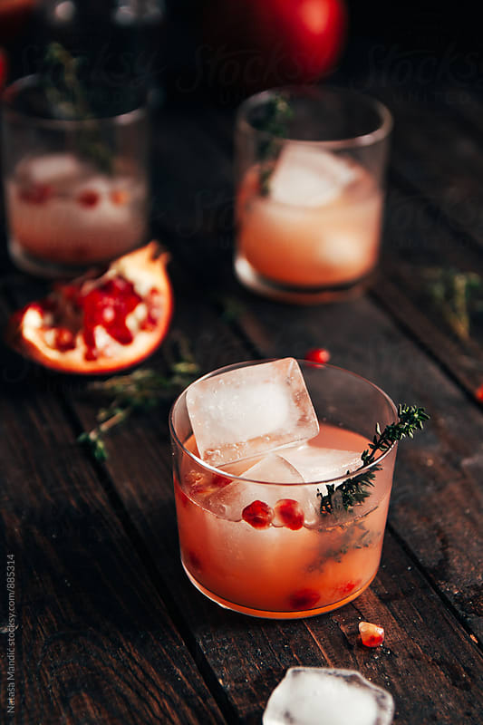 Pomegranate cocktail with thyme by Nataša Mandić for Stocksy United