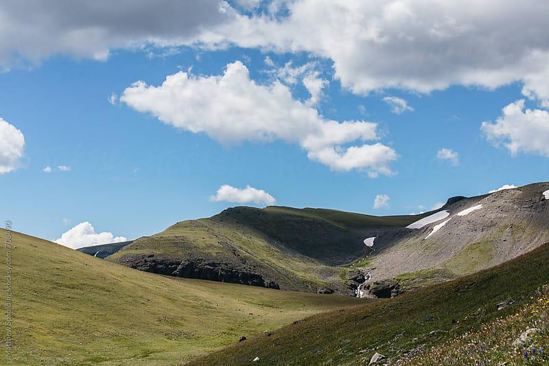 Alpine meadow in mountain landscape by Matthew Spaulding for Stocksy United