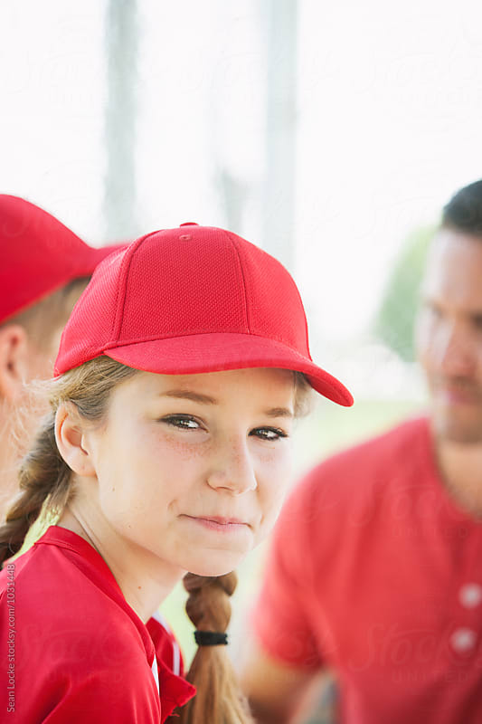 Baseball: Smiling Girl Player Sits In Dugout With Team by Sean Locke for Stocksy United