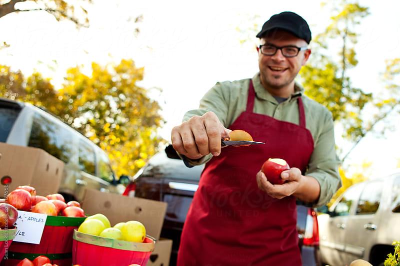 Farmer's Market: Man Giving Out Apple Samples by Sean Locke for Stocksy United