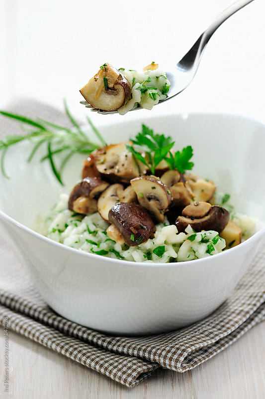 Food: Parsley and Rosemary Risotto with fried Mushrooms by Ina Peters for Stocksy United