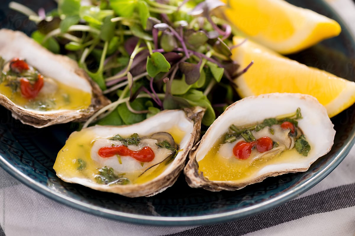 Stock Photo - Grilled Oysters With Herb Butter Sauce