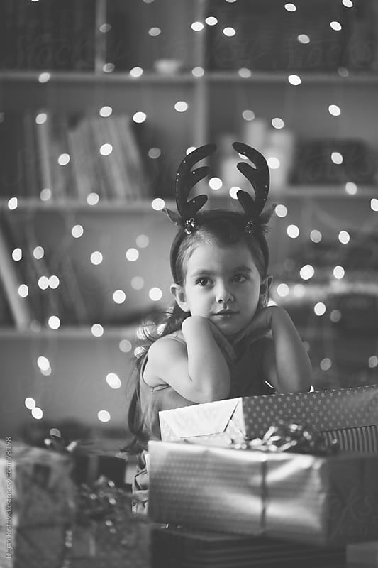 Portrait of a little girl with christmas present by Dejan Ristovski for Stocksy United