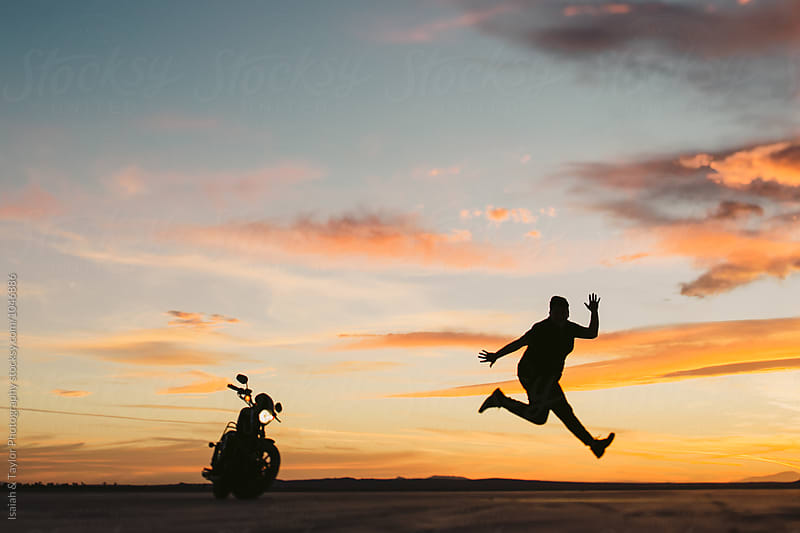 Person jumping for joy by Isaiah & Taylor Photography for Stocksy United