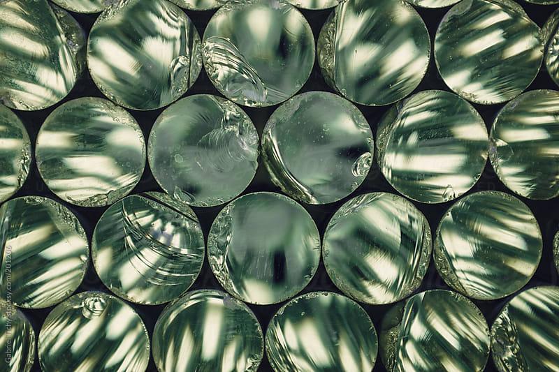 Array of glass discs by Gabriel Tichy for Stocksy United