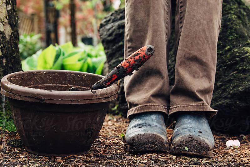 Feet of a gardening woman next to flower pots by Gabriel (Gabi) Bucataru for Stocksy United