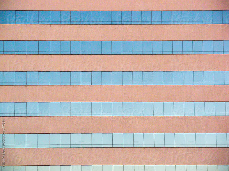 Repeating pattern of windows on a building by Mike Marlowe for Stocksy United