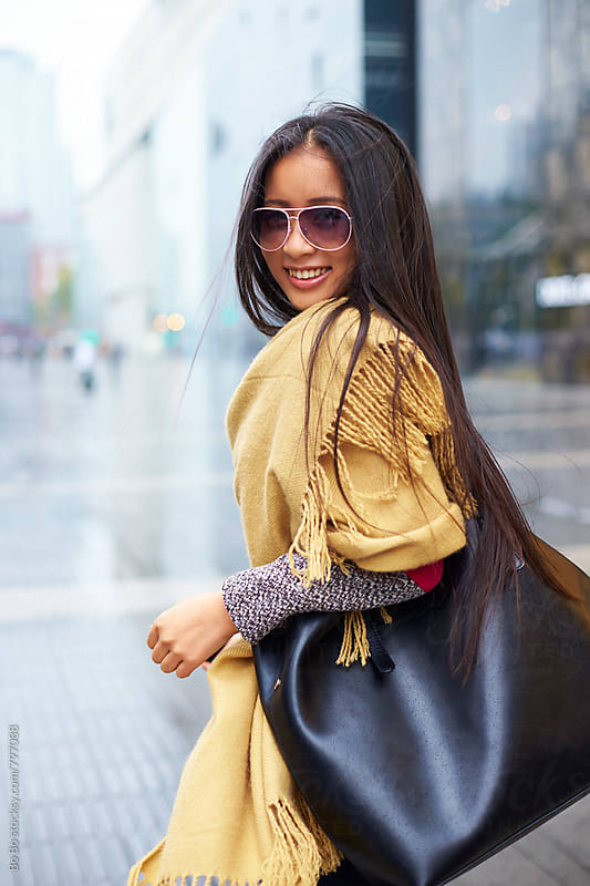 pretty young asian woman in the street by Bo Bo for Stocksy United