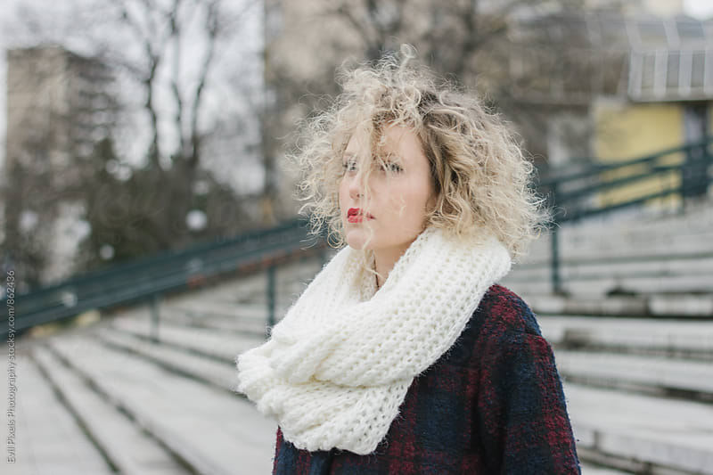 Portrait of a young beautiful curl model in winter clothes by Branislava Živić for Stocksy United