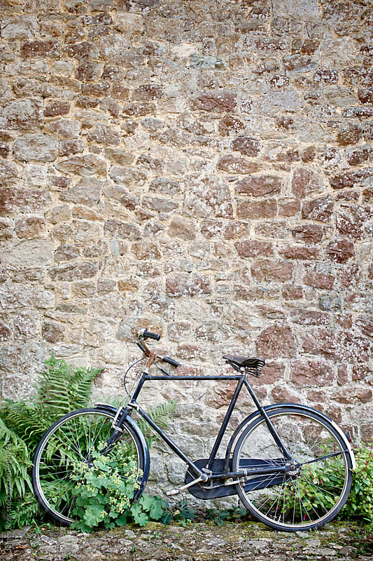 A bicycle against a wall by James Ross for Stocksy United