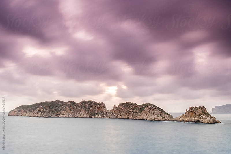Small islands in the Mediterranean Sea at sunset by Marilar Irastorza for Stocksy United