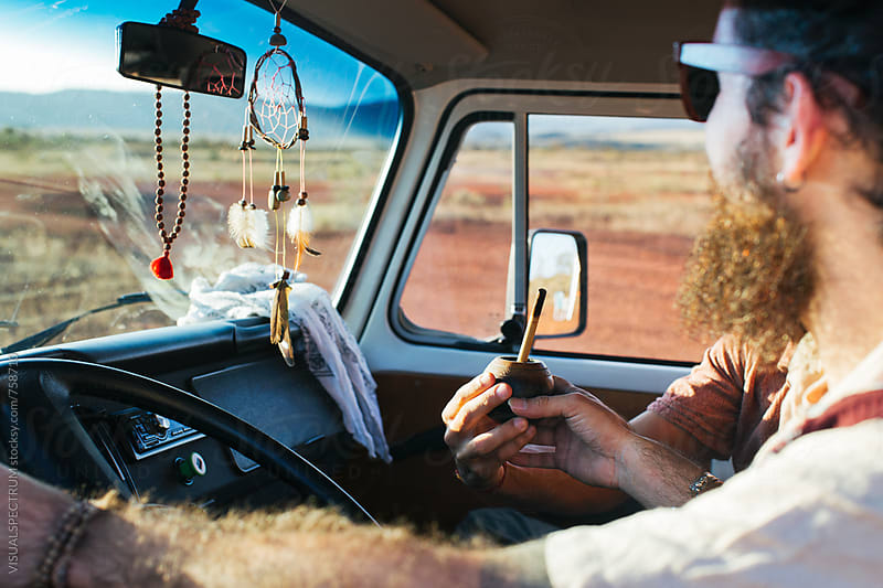 On The Road - Two Men Sharing Mate While Driving Camper Van Through South America by VISUALSPECTRUM for Stocksy United