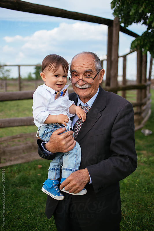 Great grandfather playing with his great grandson by Marko Milovanović for Stocksy United
