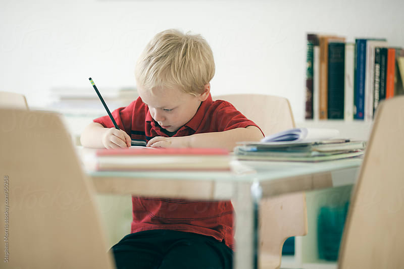 Boy Doing Homework by Stephen Morris for Stocksy United