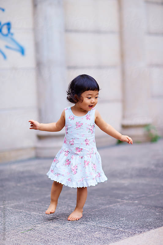one lovely little asian girl outdoor by Bo Bo for Stocksy United