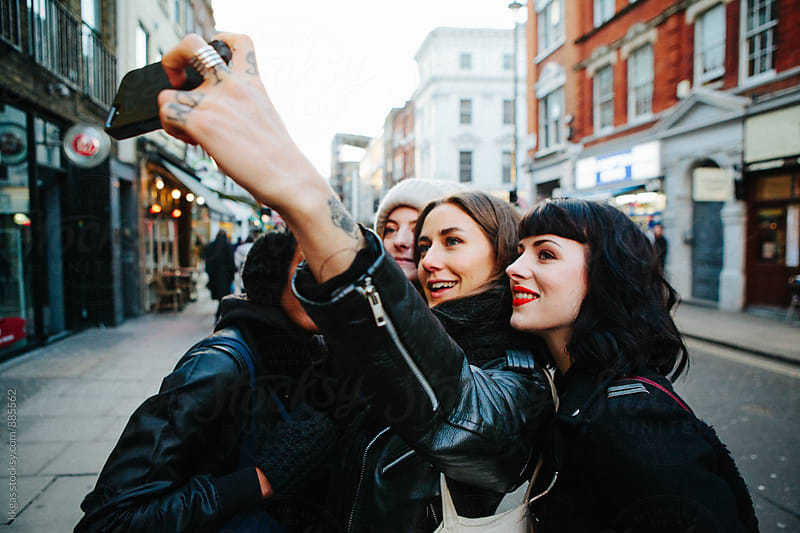 A group of beautiful young women take a selfie by kkgas for Stocksy United