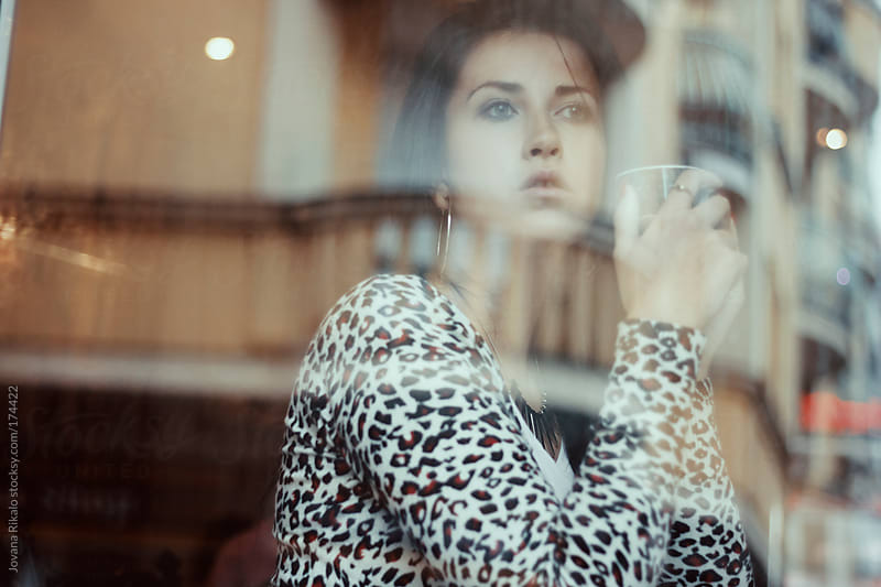 Woman sitting in a caffe bad and drinking hot tea by Jovana Rikalo for Stocksy United