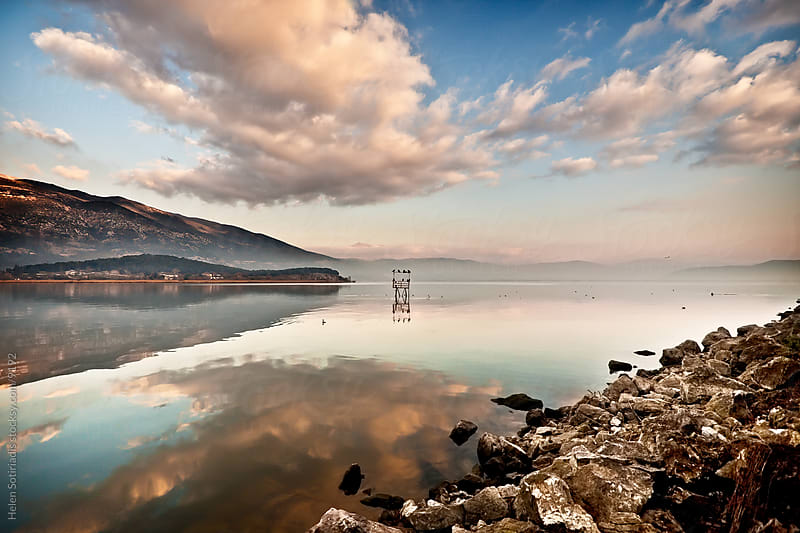 clouds reflected in a lake in greece by Helen Sotiriadis for Stocksy United