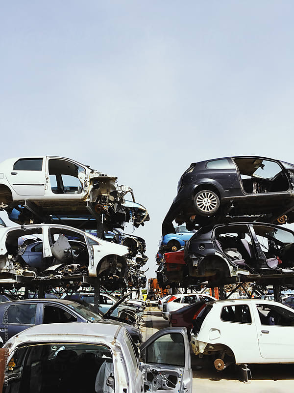 Stacked crushed cars by Luca Pierro for Stocksy United