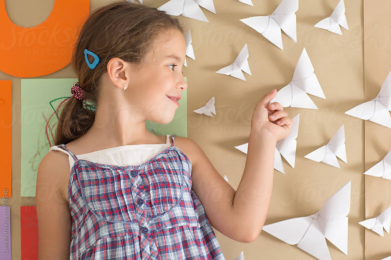 Girl and Paper Butterflies by Lumina for Stocksy United
