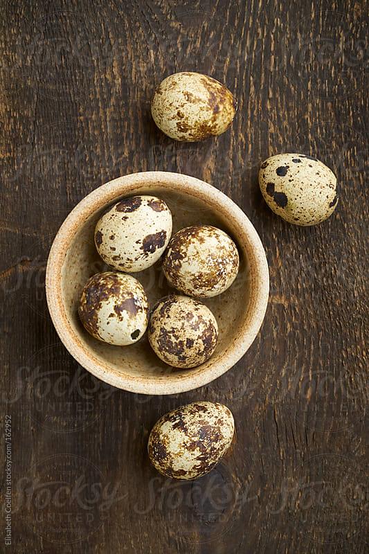 Quail eggs in a bowl by Elisabeth Coelfen for Stocksy United
