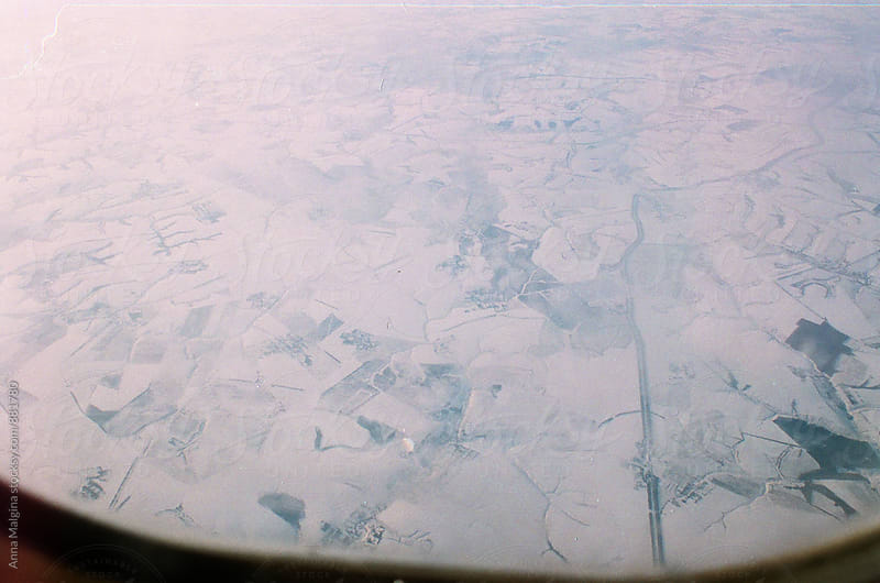 A film photo of winter earth from airplane's window by Anna Malgina for Stocksy United