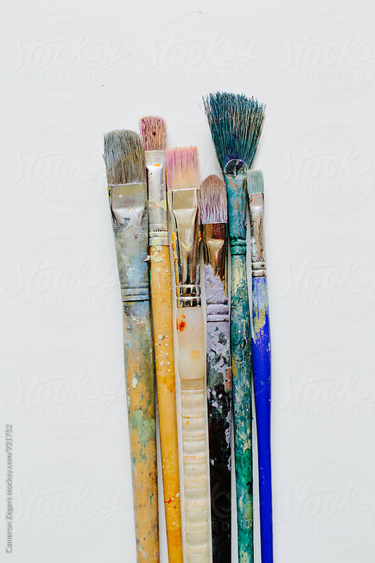 artist brushes on blank white canvas by Cameron Zegers for Stocksy United