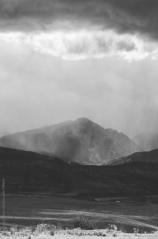 Big storm cloud above a mountain peak by Constanza Caiceo for Stocksy United