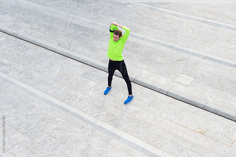 Runner training in the city by Simone Becchetti for Stocksy United