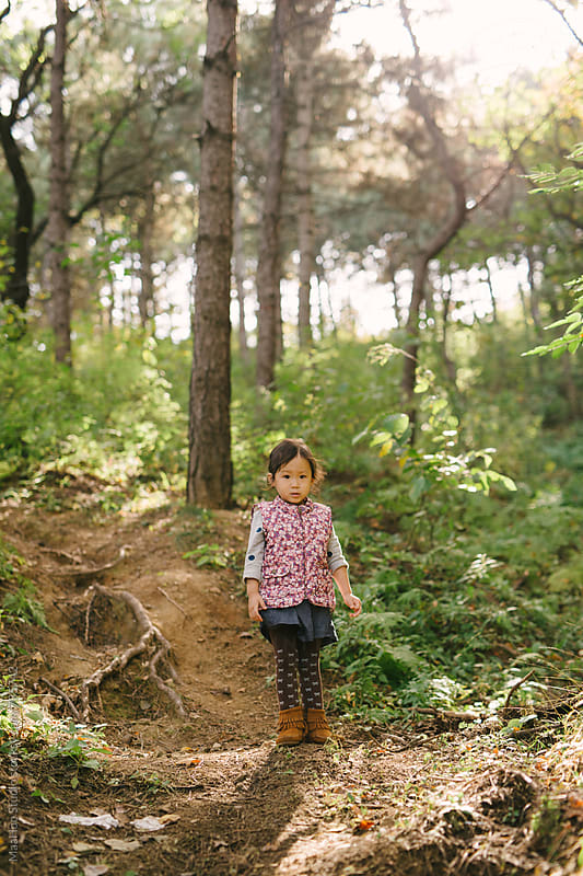 Cute toddler girl on green mountain by MaaHoo Studio for Stocksy United