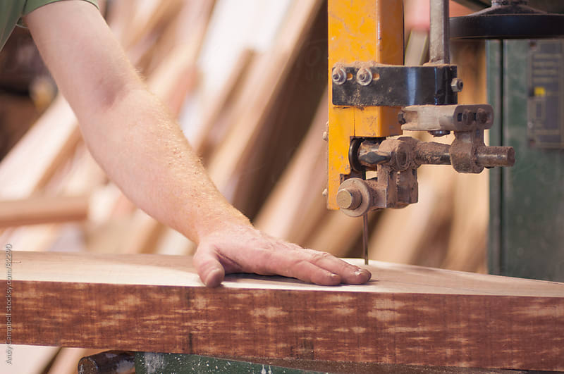 Close-up detail of a carpenter using a power saw by Andy Campbell for Stocksy United