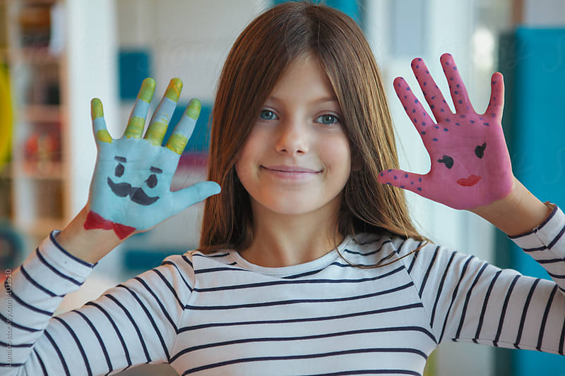 Girl With Painted Hands by Lumina for Stocksy United