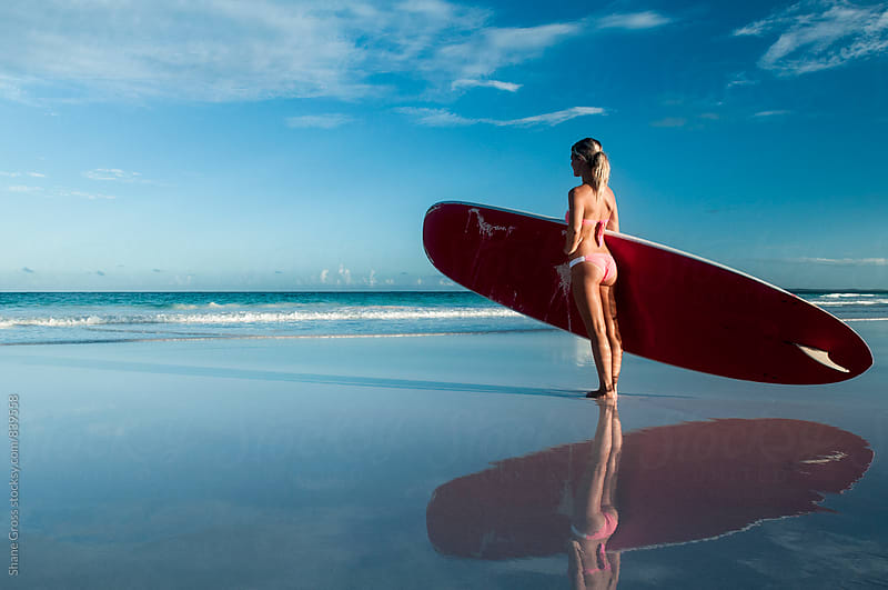Girl on Beach with Paddle Board by Shane Gross for Stocksy United