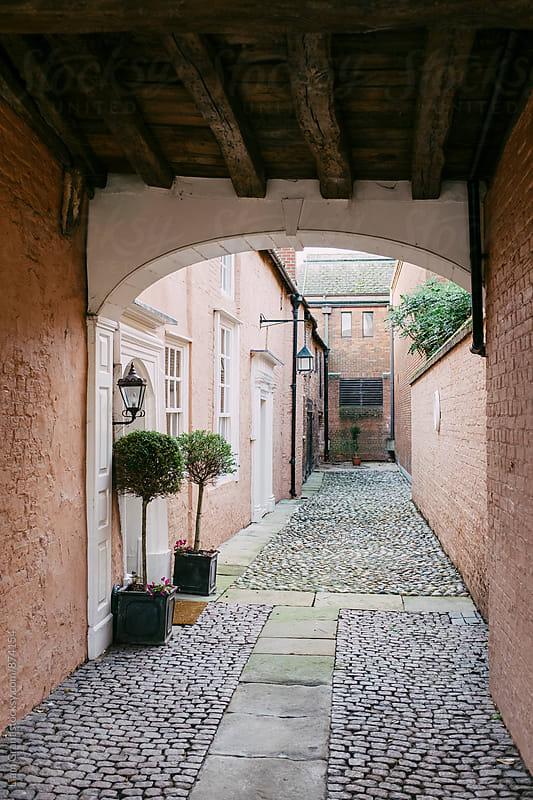 Alleyway between buildings. Kings Lynn, Norfolk, UK. by Liam Grant for Stocksy United