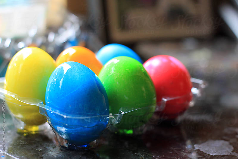 Bright, colorful Easter Eggs after being dyed by Monica Murphy for Stocksy United