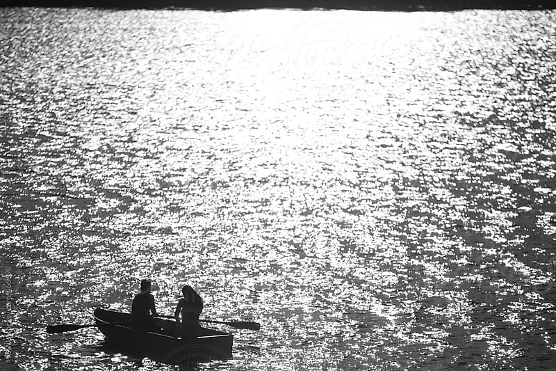 A romantic young couple has private moment alone in a boat  by HOWL for Stocksy United