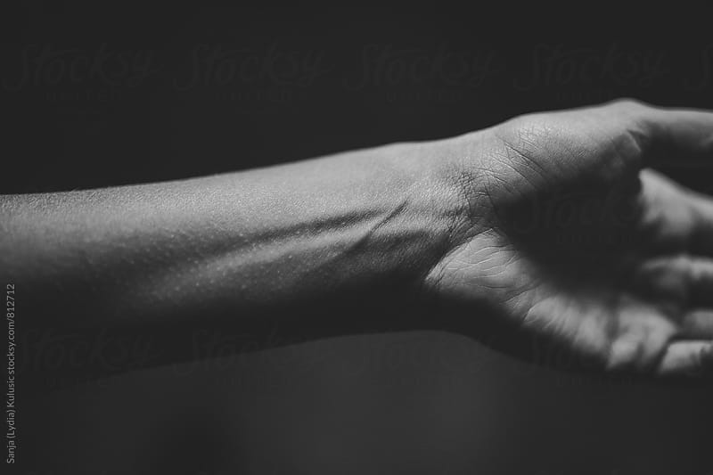 Wrist detail of a tiny hand with visible veins in black and white by Sanja (Lydia) Kulusic for Stocksy United