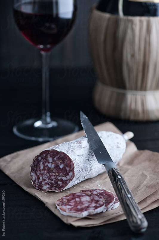 Food: Fennel Seed Salami and Chianti, red wine by Ina Peters for Stocksy United