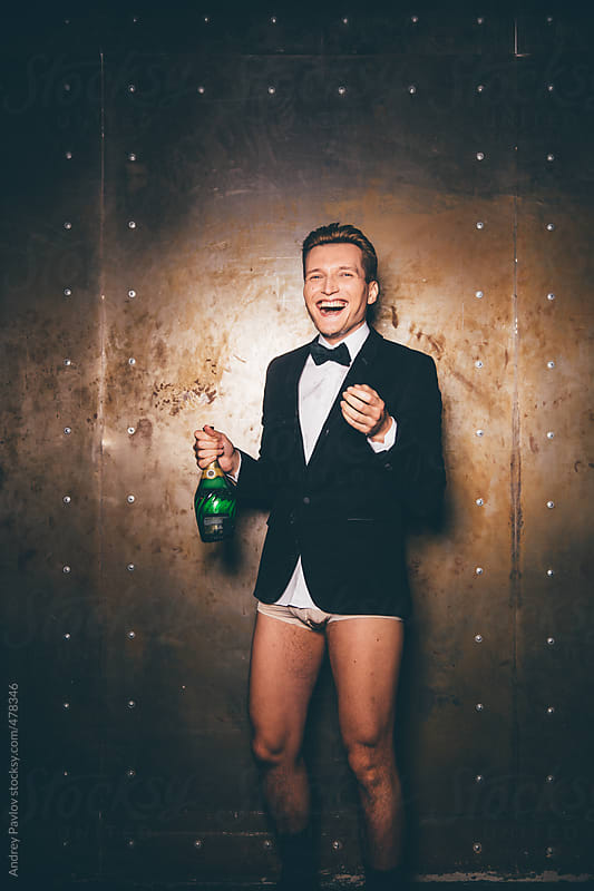 Men dressed in a suit and underpants laugh by Andrey Pavlov for Stocksy United